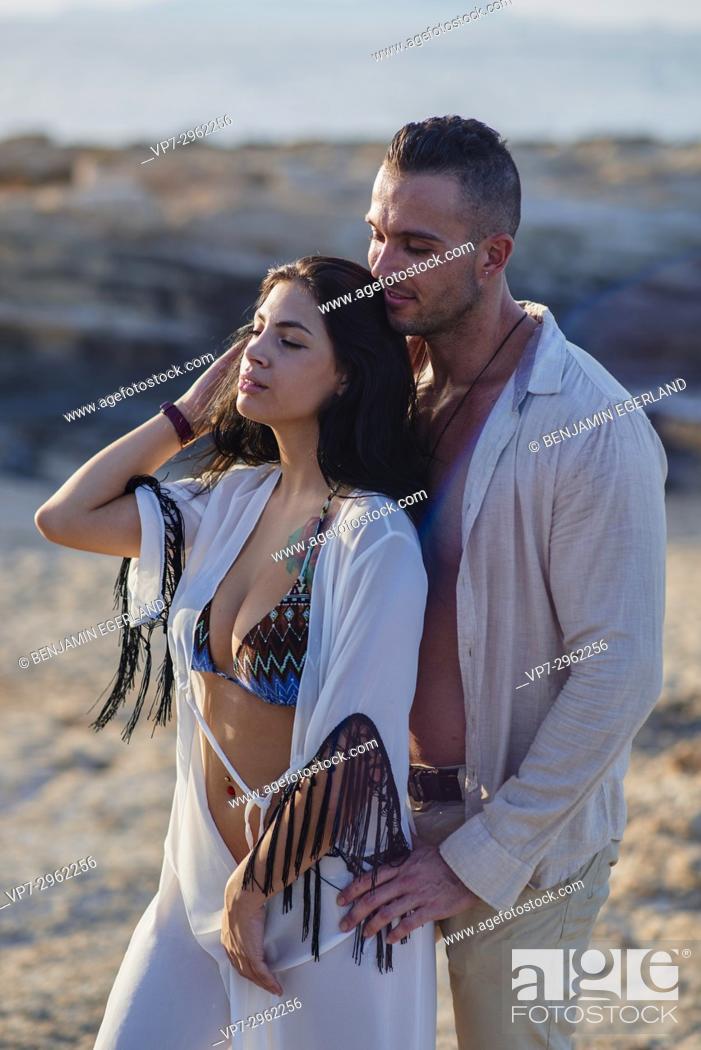 Stock Photo: sensual couple enjoying togetherness at beach. Greek ethnicity. In holiday destination Hersonissos, Crete, Greece.