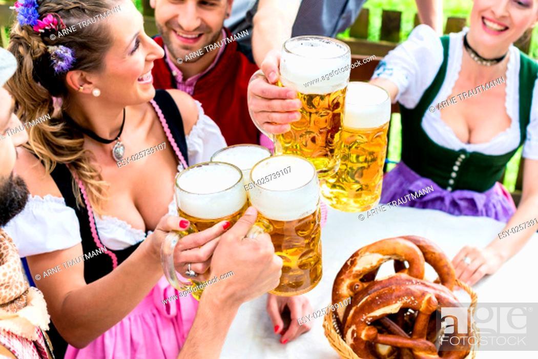 Stock Photo: Maßkrüge und Brezn in Biergarten Bayern.