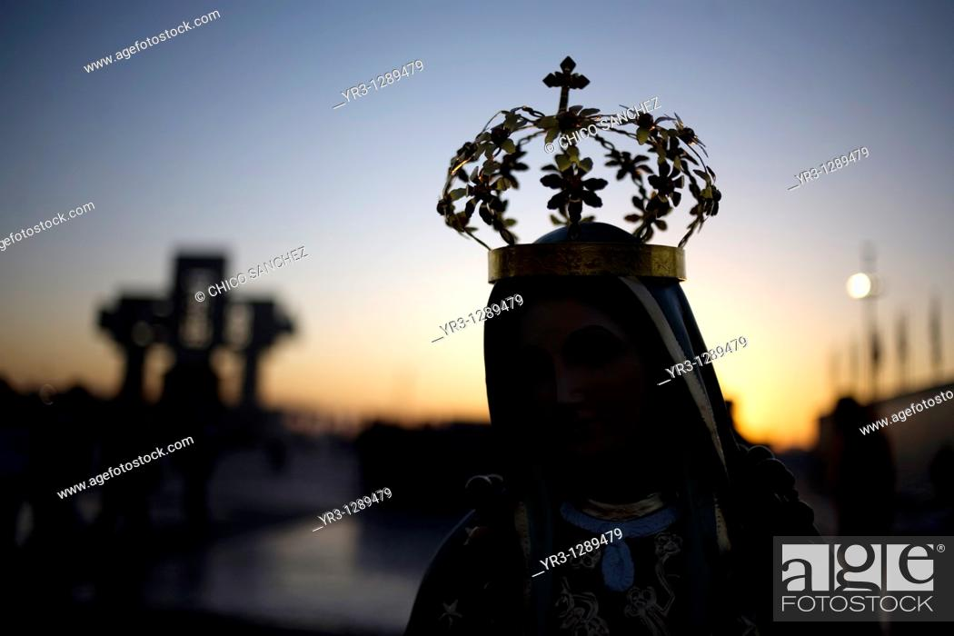 Stock Photo: A statue of Our Lady of Guadalupe is silhouetted against the sunrise in Mexico City, December 10, 2010  Hundreds of thousands of Mexican pilgrims converged on.