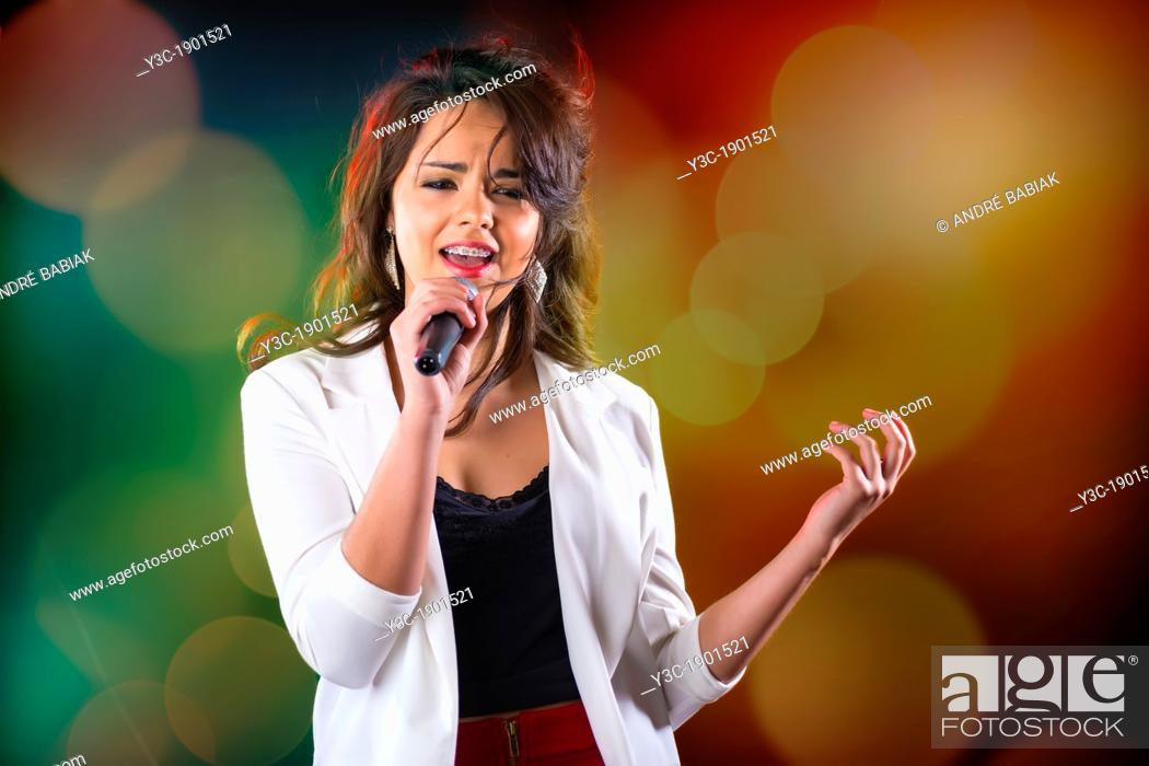 Stock Photo: USA, Texas, Female Hispanic girl (16-17) singing.