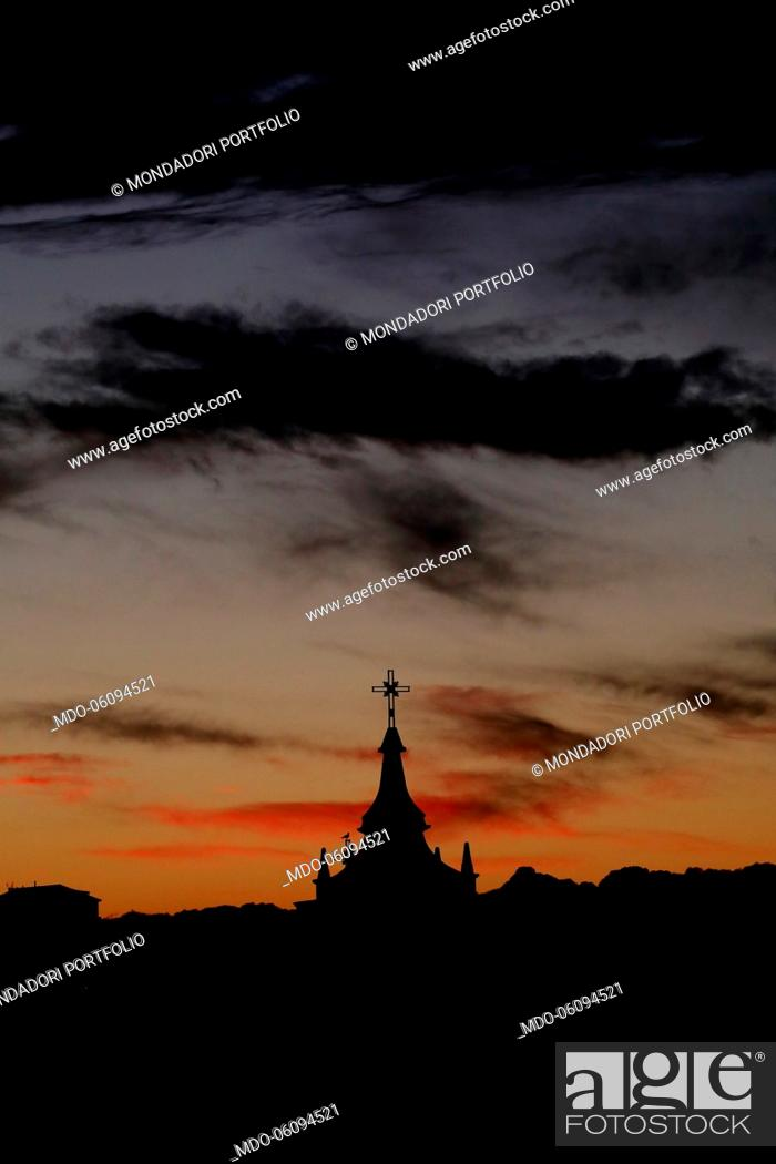 Stock Photo: Bell tower at the sunset with the cross. Vatican City, November 27th, 2018.