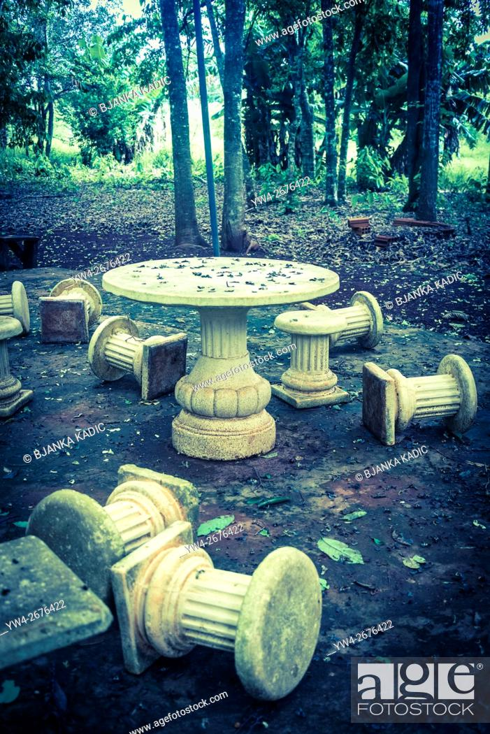 Stock Photo: Fallen columns, picnic chairs.