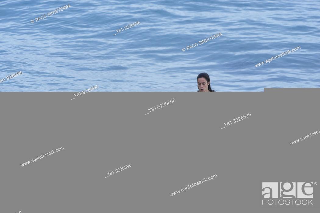 Stock Photo: Girl doing paddleboard, Alcocebre, Castellon province, Valencian Community, Spain.