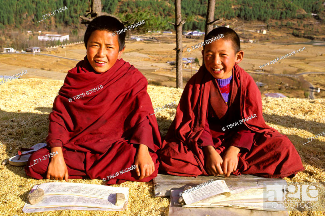 Stock Photo: Young Buddhist monks studying the scriptures. Thimpu. Bhutan.