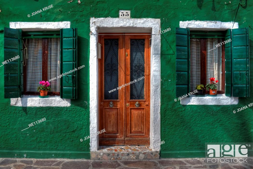 Stock Photo: Door and two windows with shutters in Burano, near Venice, Italy.