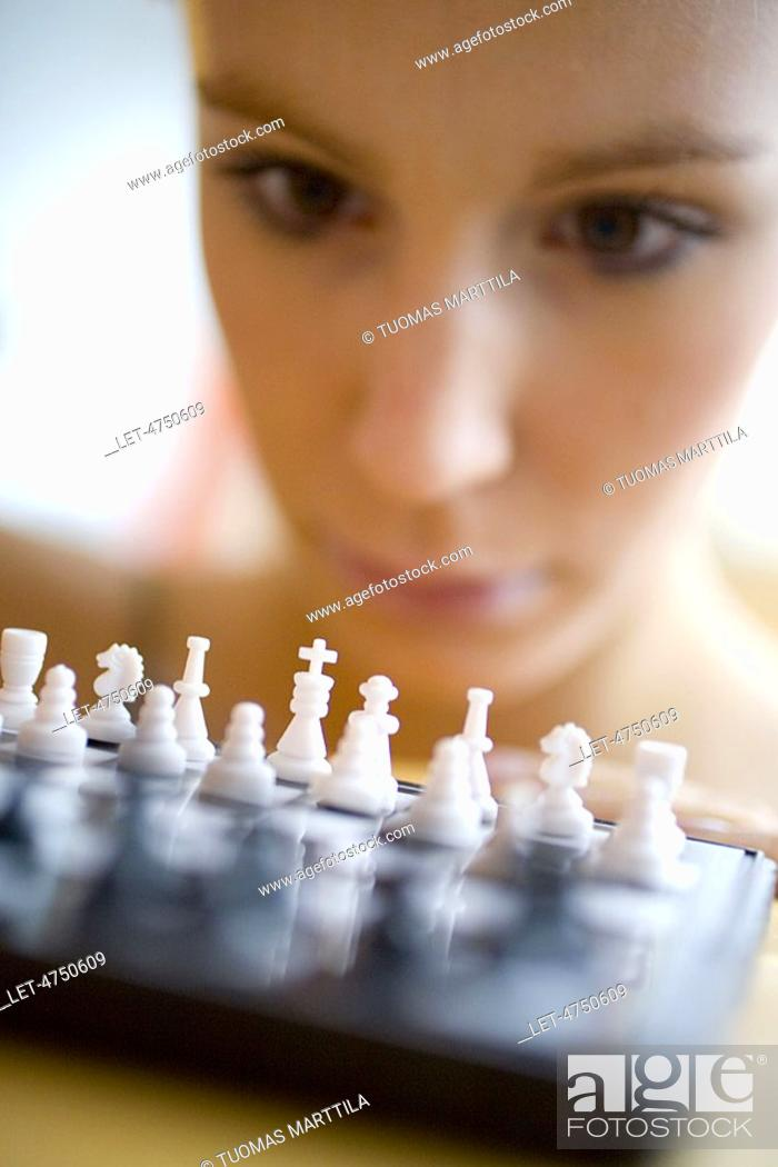 Stock Photo: Woman playing chess.