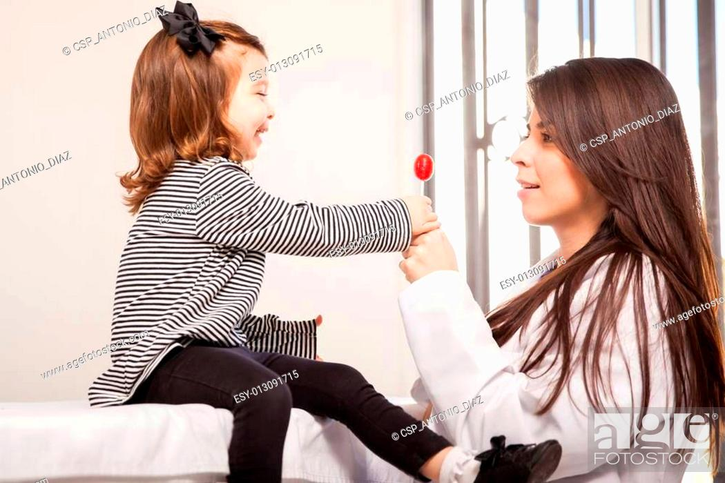Stock Photo: Little girl getting a lollipop.