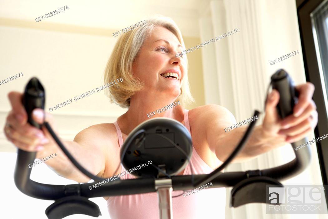 Stock Photo: Senior Woman On Exercise Bike.