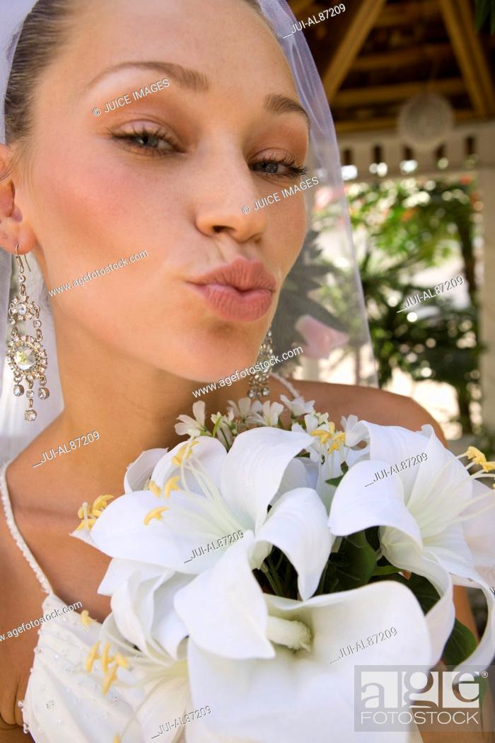 Stock Photo: Close up of bride blowing a kiss.