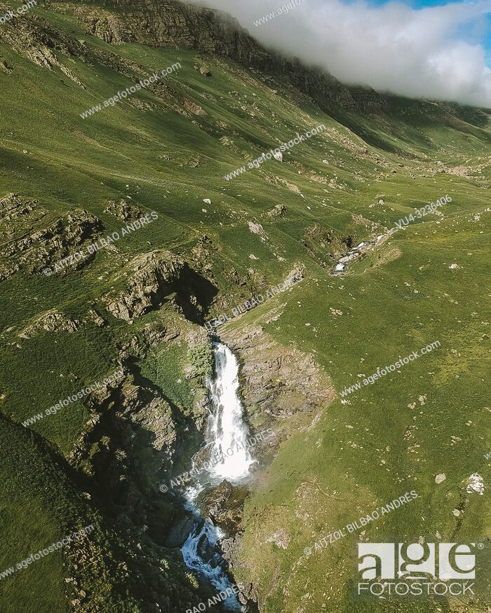 Stock Photo: Las Negras waterfall, Izas valley in the Pyrenees, snow in gone and the valley turns green.