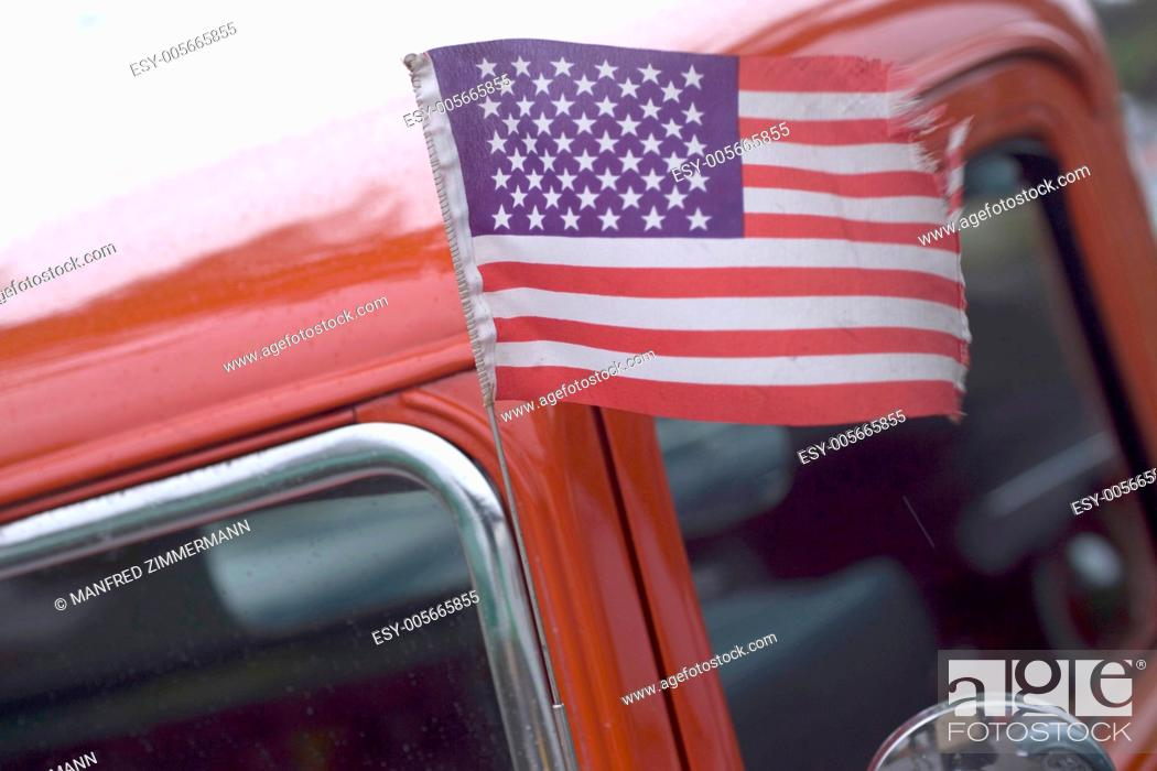 Stock Photo: American flag blowing in the Ford.