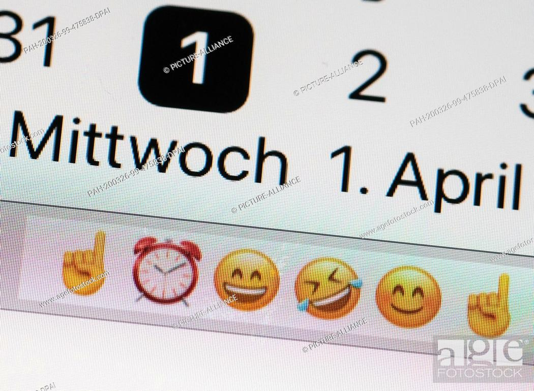 Stock Photo: ILLUSTRATION - 25 March 2020, Berlin: On the display of a smartphone, the calendar on April 1 contains warning and laughing emojis.