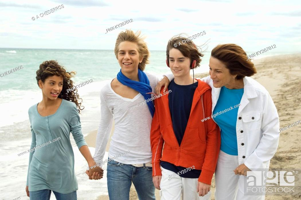 Stock Photo: Family on the beach.