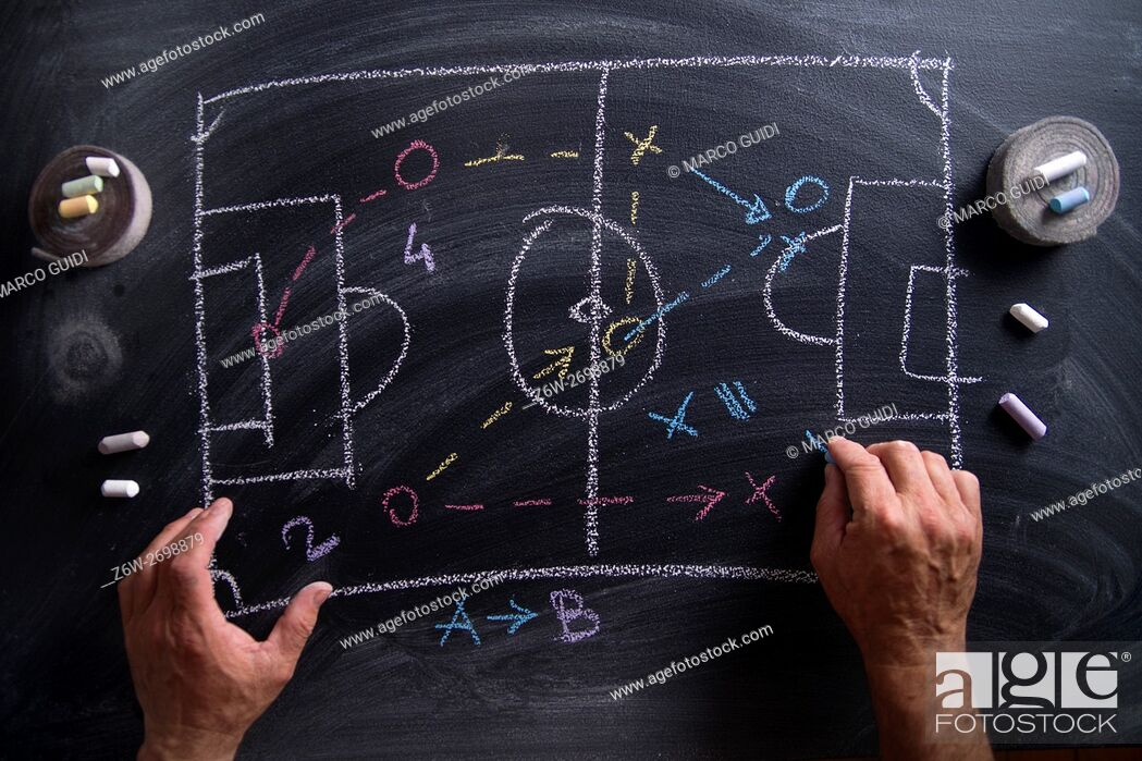 Stock Photo: Lesson in tactics and the football patterns drawn with chalk on blackboard.