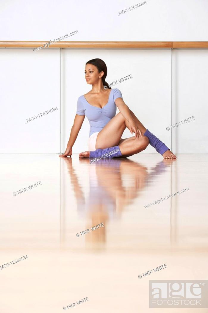 Stock Photo: Dancer Stretching Before Rehearsal.