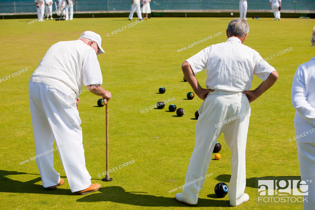 Stock Photo: Old people playing bowls at Penzance in West Cornwall, UK.