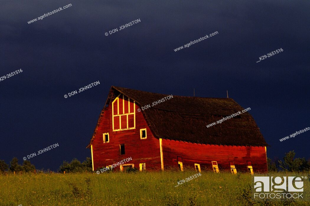 Stock Photo: Red barn and receding thunderstorm, Duluth, Wisconsin, USA.