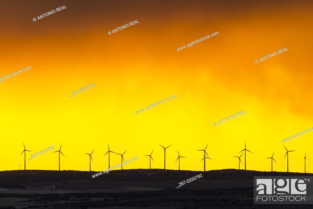 Stock Photo: Windfarm and sunset sky. Almansa. Albacete province, Castile-La Mancha, Spain.