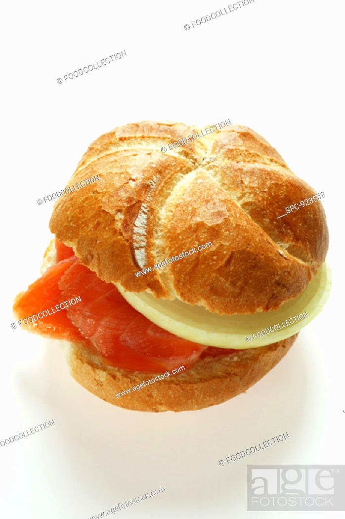 Stock Photo: Bread roll with smoked salmon and onion.