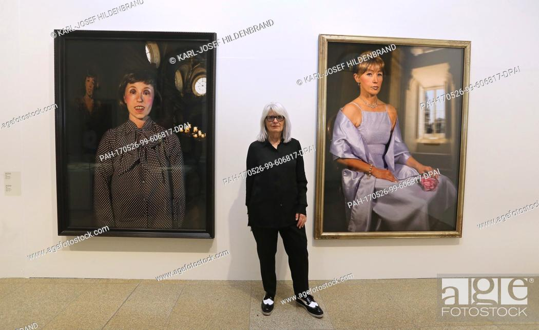 Stock Photo: Monika Sprüth poses between works by art photographer Cindy Sherman at the Mewo-Kunsthalle in Memmingen, Germany, 18 May 2017.