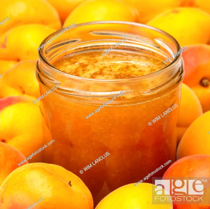 Stock Photo: Apricot jam in jar with apricots.