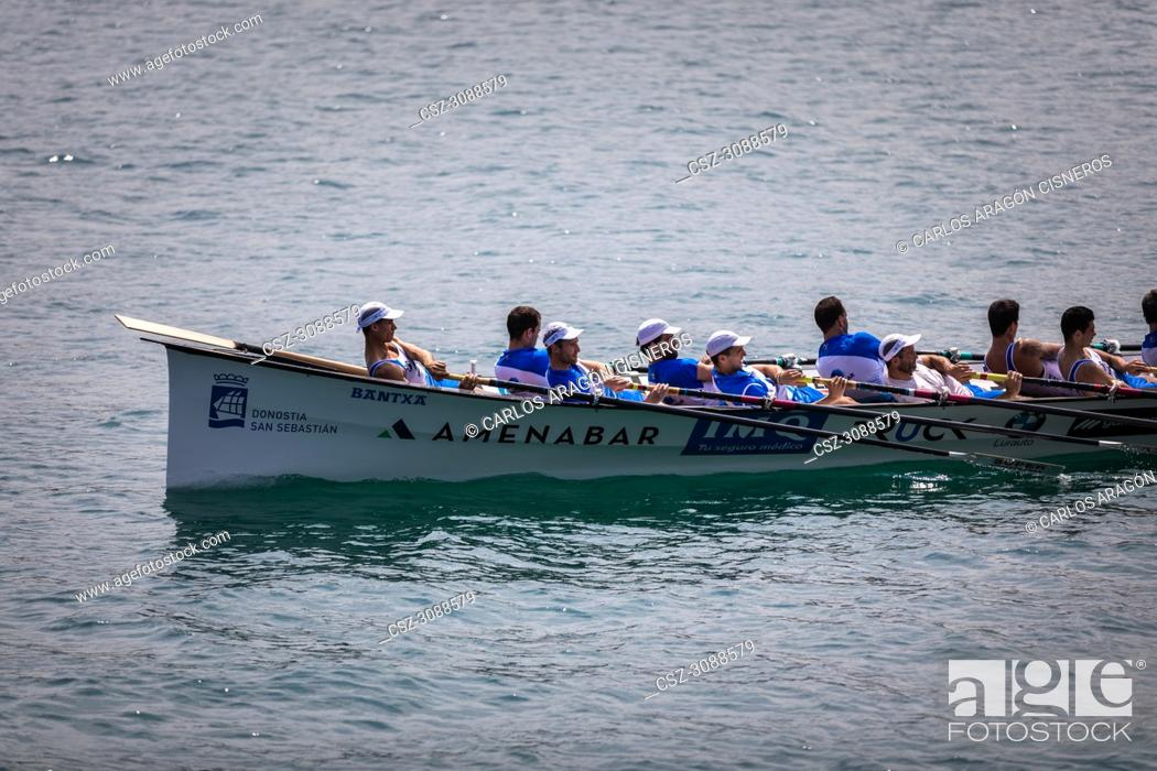 Stock Photo: CASTRO URDIALES, SPAIN - JULY 15, 2018: Competition of boats, regata of trainera, Donostiarra boat in action in the VI Bandera CaixaBank competition.