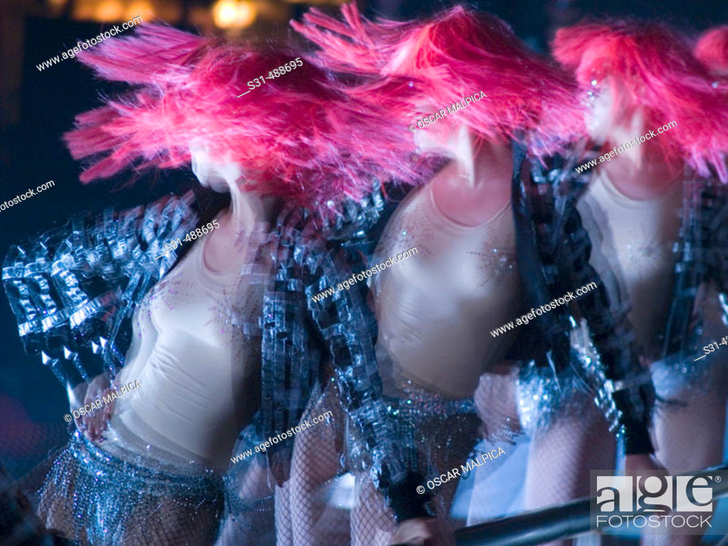 Stock Photo: Russian dancers wearing pink wigs on show.