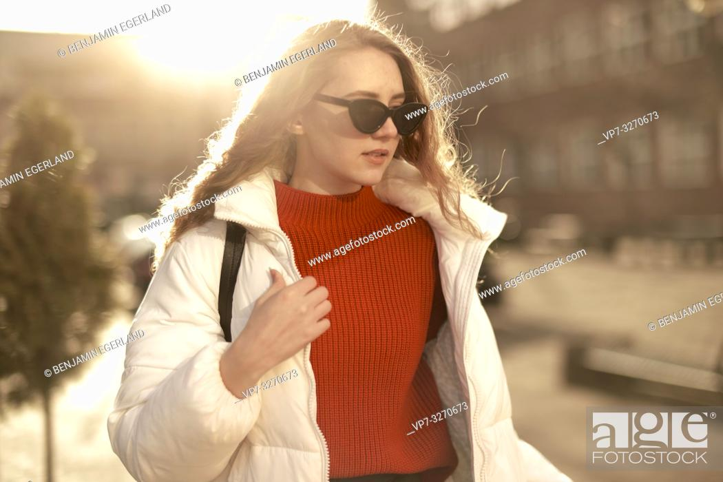 Stock Photo: young stylish woman wearing sunglasses, upper body shot, in city Cottbus, Brandenburg, Germany.
