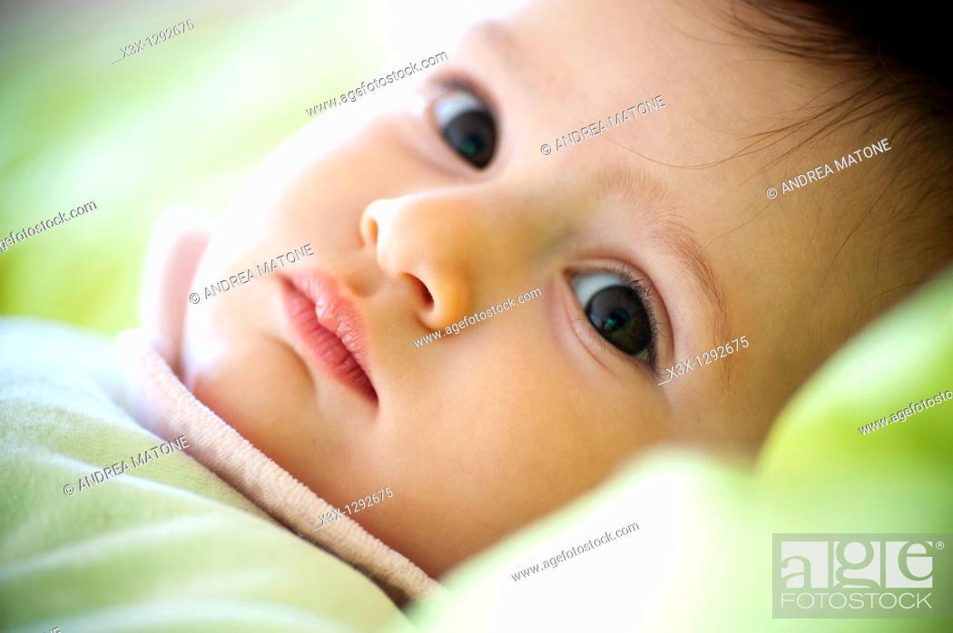 Stock Photo: Baby girl looking back.