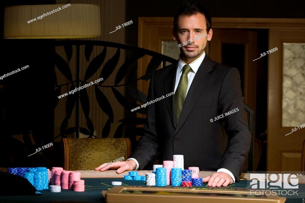 Stock Photo: Young man gambling, portrait.