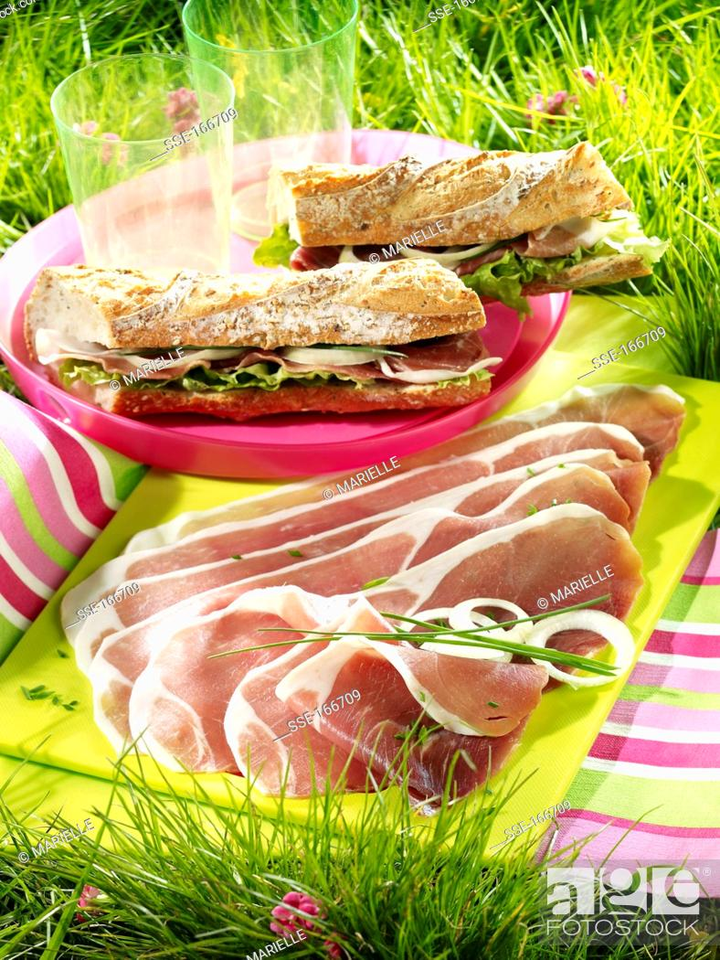 Stock Photo: A plate of Bayonne ham and sandwiches.