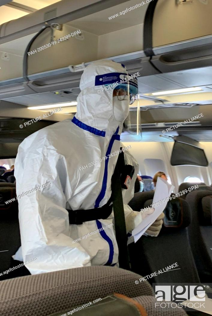 Stock Photo: 29 May 2020, ---: An official of the Chinese health authority, who wears a Covid-19 protective suit and face visor to protect against infection.