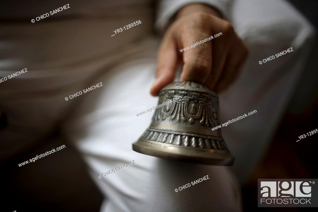 Stock Photo: A Reiki Master holds a bell during a meditation in Mexico City. Reiki is a spiritual practice developed in 1922 by Japanese Buddhist Mikao Usui.