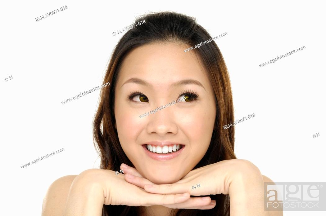 Stock Photo: Smiling woman isolated on white background.
