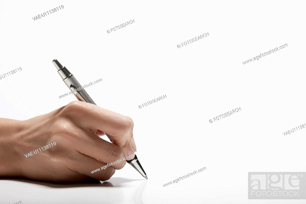 Stock Photo: Woman's hand holding pen close-up.