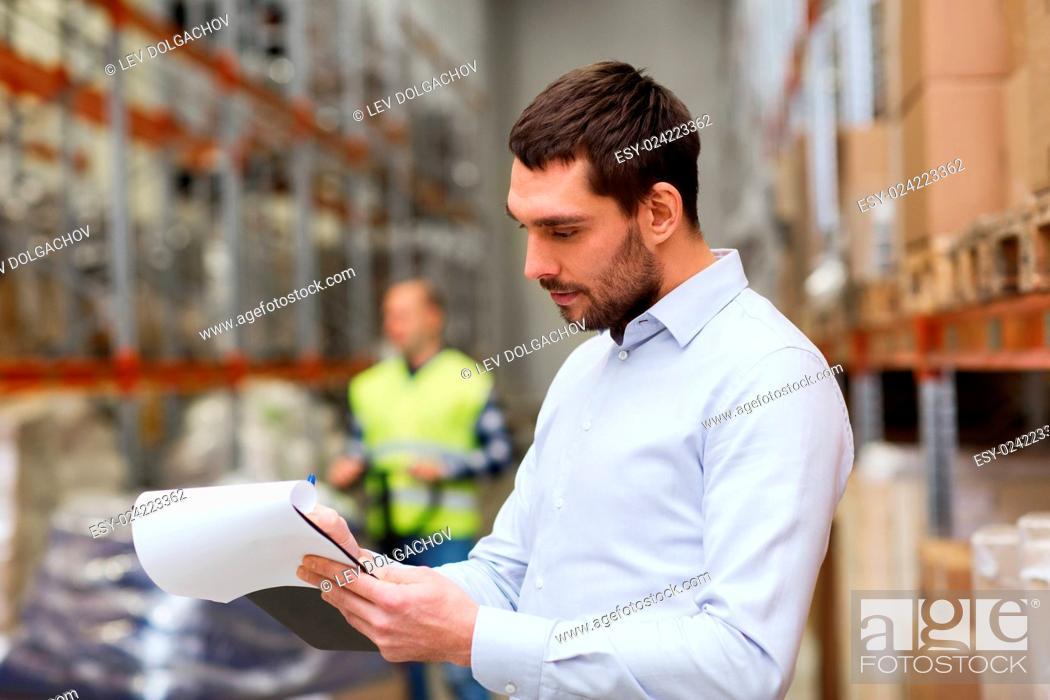 Stock Photo: wholesale, logistic, people and export concept - businessman or supervisor with clipboards at warehouse.