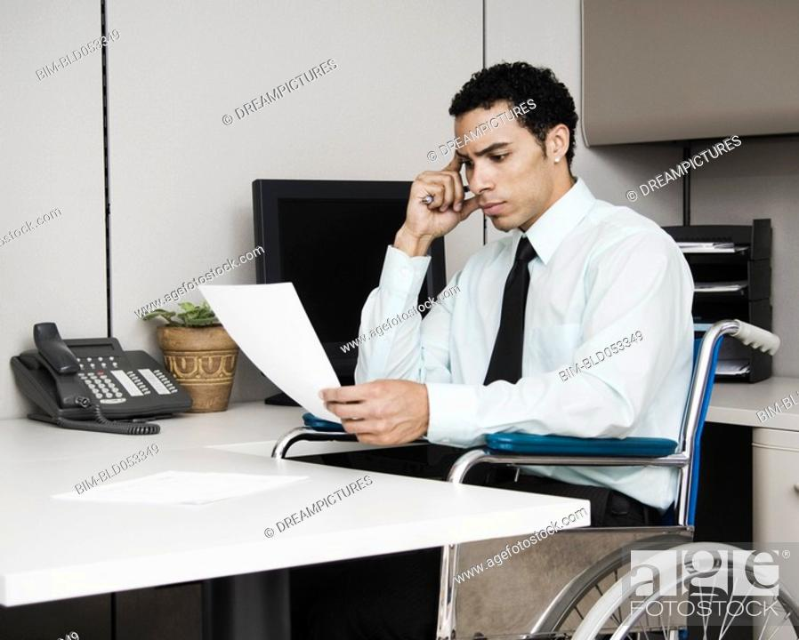 Stock Photo: Mixed Race businessman in wheelchair.