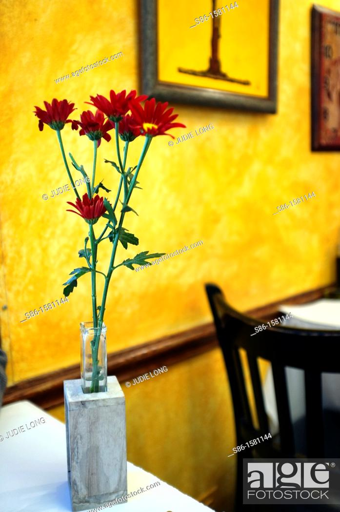 Stock Photo: Bud Vase of Red Flowers on a Cafe Restaurant Table.