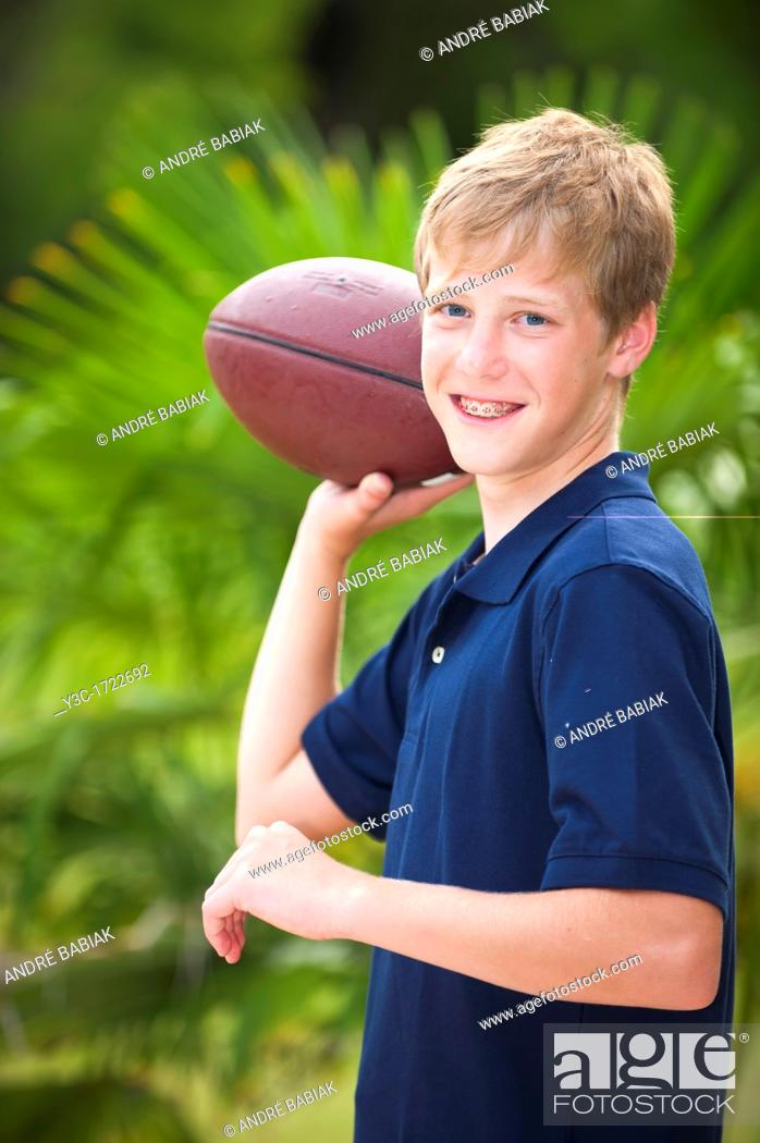 Stock Photo: Young boy with american football.