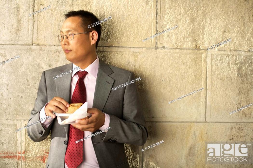 Stock Photo: Businessman with sandwich.