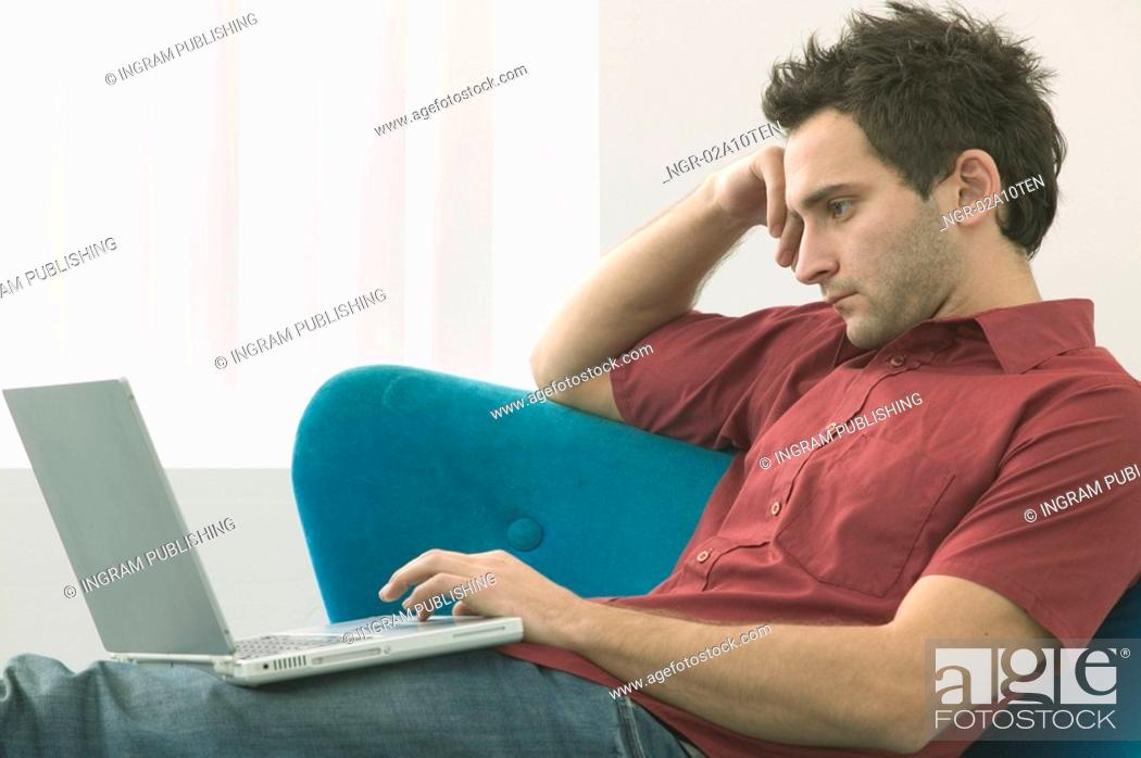 Stock Photo: Pensive Guy with Laptop.