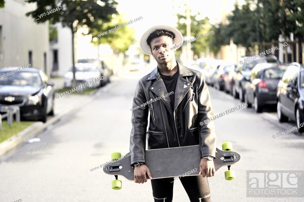 Stock Photo: Man with skateboard. Munich, Germany.