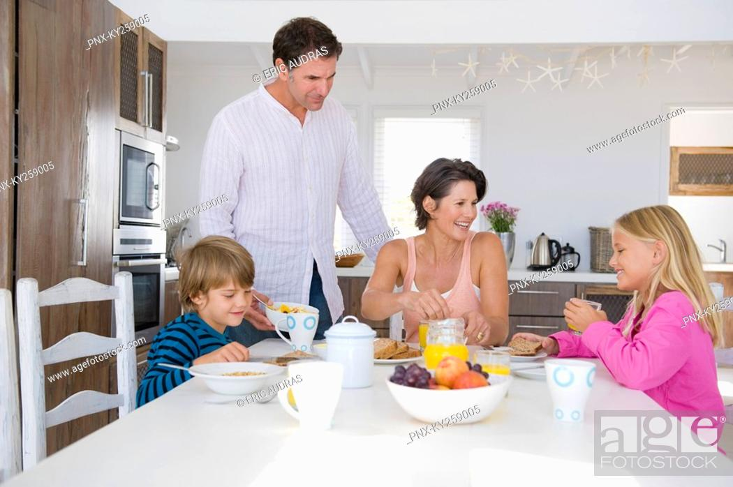 Stock Photo: Family having breakfast at the dining table.