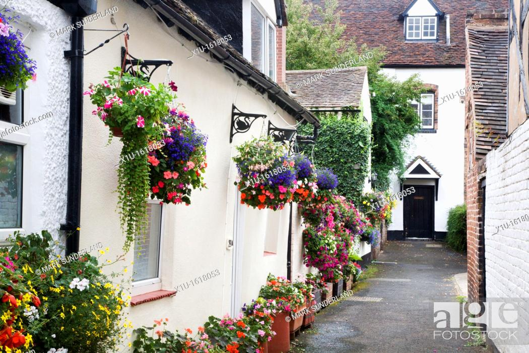 Stock Photo: Hanging Baskets in an Alleyway Bridgnorth Shropshire England.