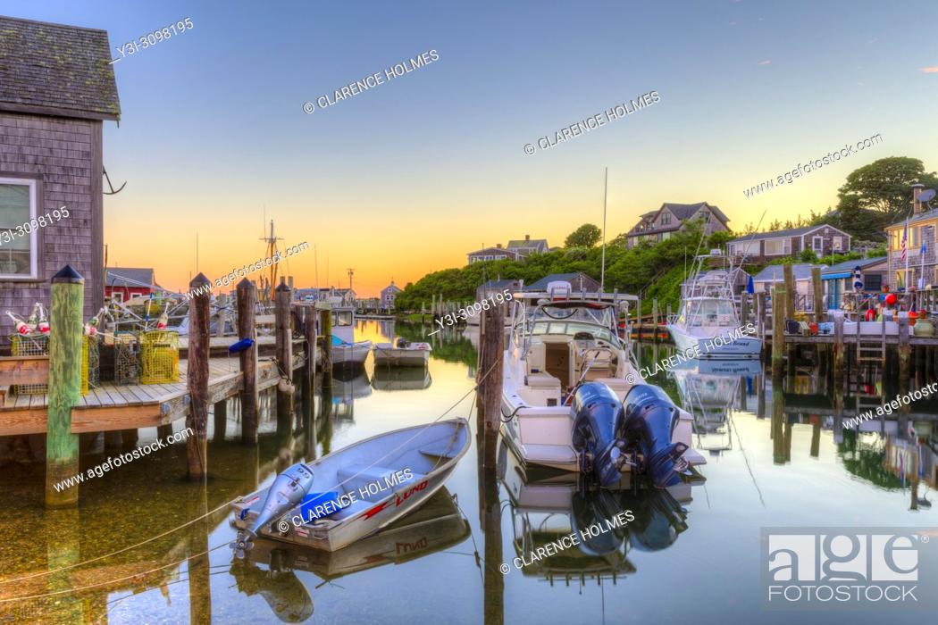 Stock Photo: The commercial fishing village of Menemsha and boats docked in Menemsha Basin under a colorful sky during morning twilight, in Chilmark.