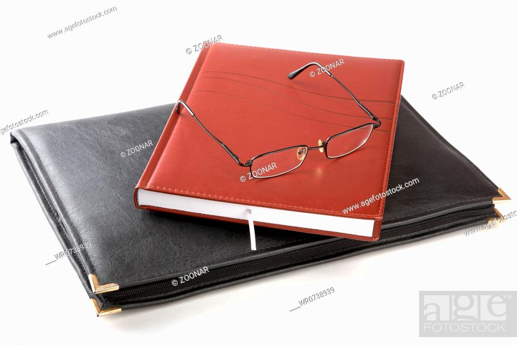 Stock Photo: Folder for papers an organizer and glasses.