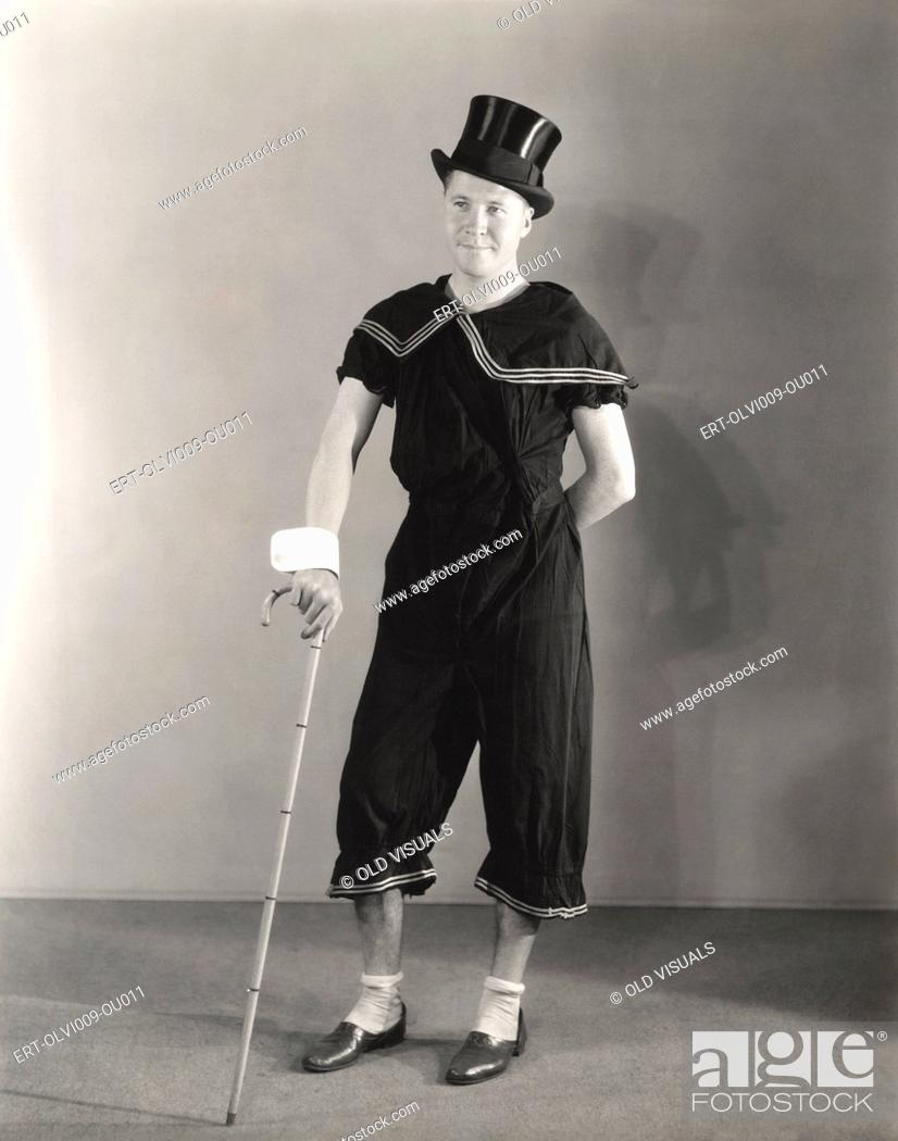 Stock Photo: Man posing in cuffs, top hat and circus costume.