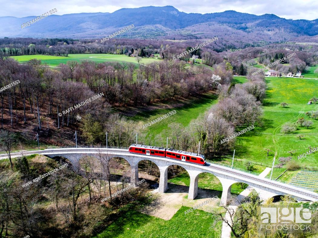 Stock Photo: Aerial view of train on viaduct.