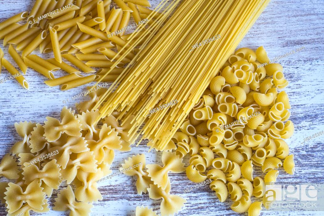 Stock Photo: Varied pasta on a table.