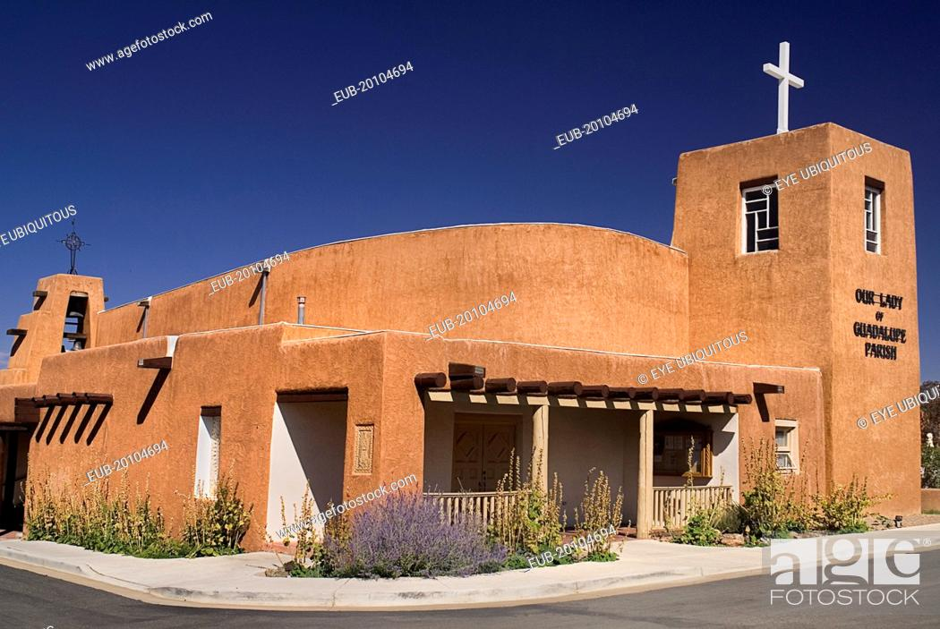Stock Photo: Our Lady of Guadalupe Parish Church built in the typical adobe style architecture.